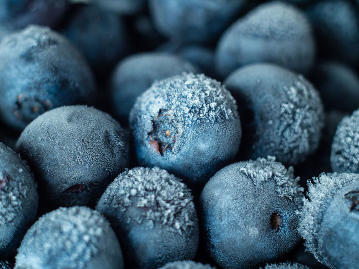 Healthy Breakfast: Close up of frozen blueberries, macro shot, top view Blueberry Breakfast Frozen Food Vegan Fruit Antioxidant Food And Drink Food Full Frame Close-up Freshness Backgrounds No People Wellbeing Indoors  Healthy Eating Large Group Of Objects Abundance Selective Focus Still Life Berry Fruit Sweet Food Stack Heap Temptation Navy Blue