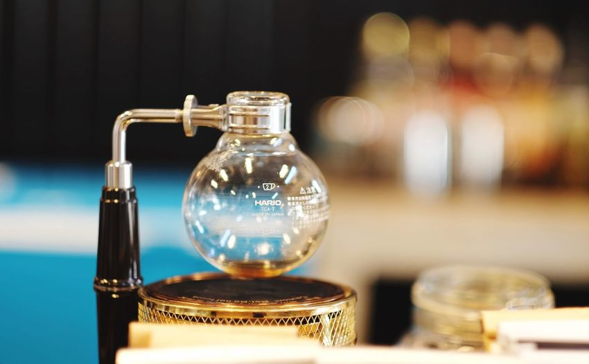 Syphon matchine Matchine Syphone Coffe  Glass - Material Transparent Container Table Close-up No People Indoors  Still Life Focus On Foreground Bottle Glass Reflection Chemistry Selective Focus Jar Laboratory Science Perfume Sprayer