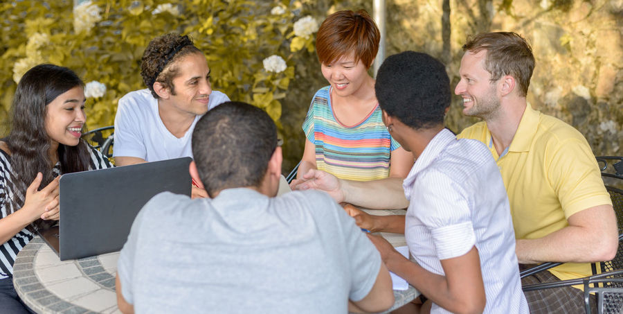 Adult Bonding Cheerful Communication Day Discussion Friendship Happiness Lifestyles Mature Adult Medium Group Of People Men Outdoors People Reunion - Social Gathering Sitting Smiling Social Gathering Talking Teamwork Togetherness Women Young Adult Young Men Young Women