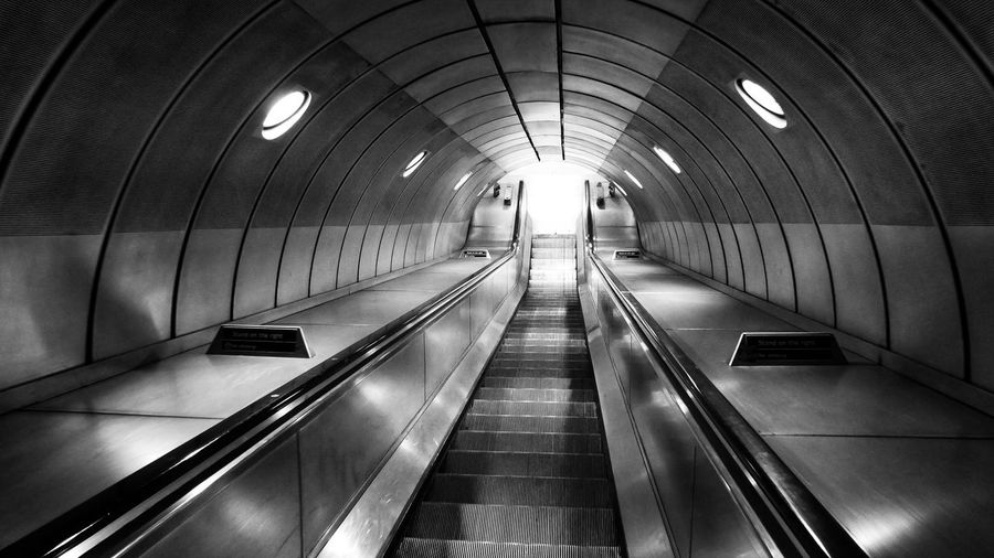 Photowalktheworld Illuminated Technology Subway Station Architecture Built Structure Moving Walkway  Recessed Light Escalator Steps And Staircases Transportation Building - Type Of Building Subway vanishing point Diminishing Perspective Spiral Staircase