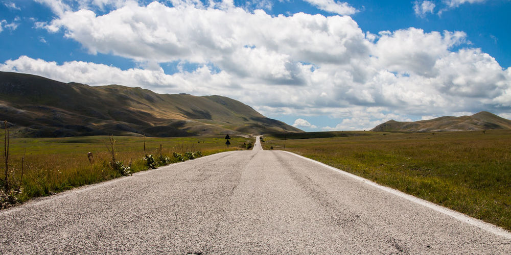road between the Abruzzo mountains. Italian Apennines in summer Abruzzo Cloud Infinito Montagne Nuvole Road Travel Appennino Asfalto Clouds Infinity Landscape Linee Montagna Mountain On The Road Paesaggio Prospettiva Strada Wide