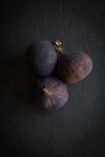 Beautiful fresh blue violet figs on dark stone background with empty copyspace close up vie from above. Studio Shot Healthy Eating Food Food And Drink Wellbeing Still Life Freshness Indoors  No People Close-up Fruit Two Objects Black Background Fig Vegetable Gray Colored Background Table Gray Background Organic Purple Ripe