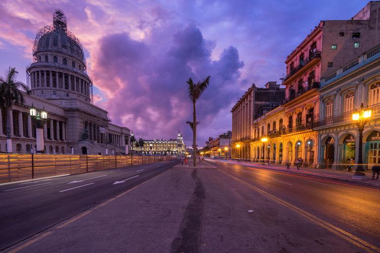 Illuminated Street By El Capitolio Against Sky