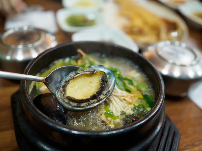Korea Korean Food Meal Steaming Travel Abalone Asian Food Busan Close-up Delicious Food Food And Drink Freshness Healthy Eating Hotpot Korean Food Korean Style Local Food Ready-to-eat Seafood Soup Steaming Hot Temptation Traditional Food Wellbeing