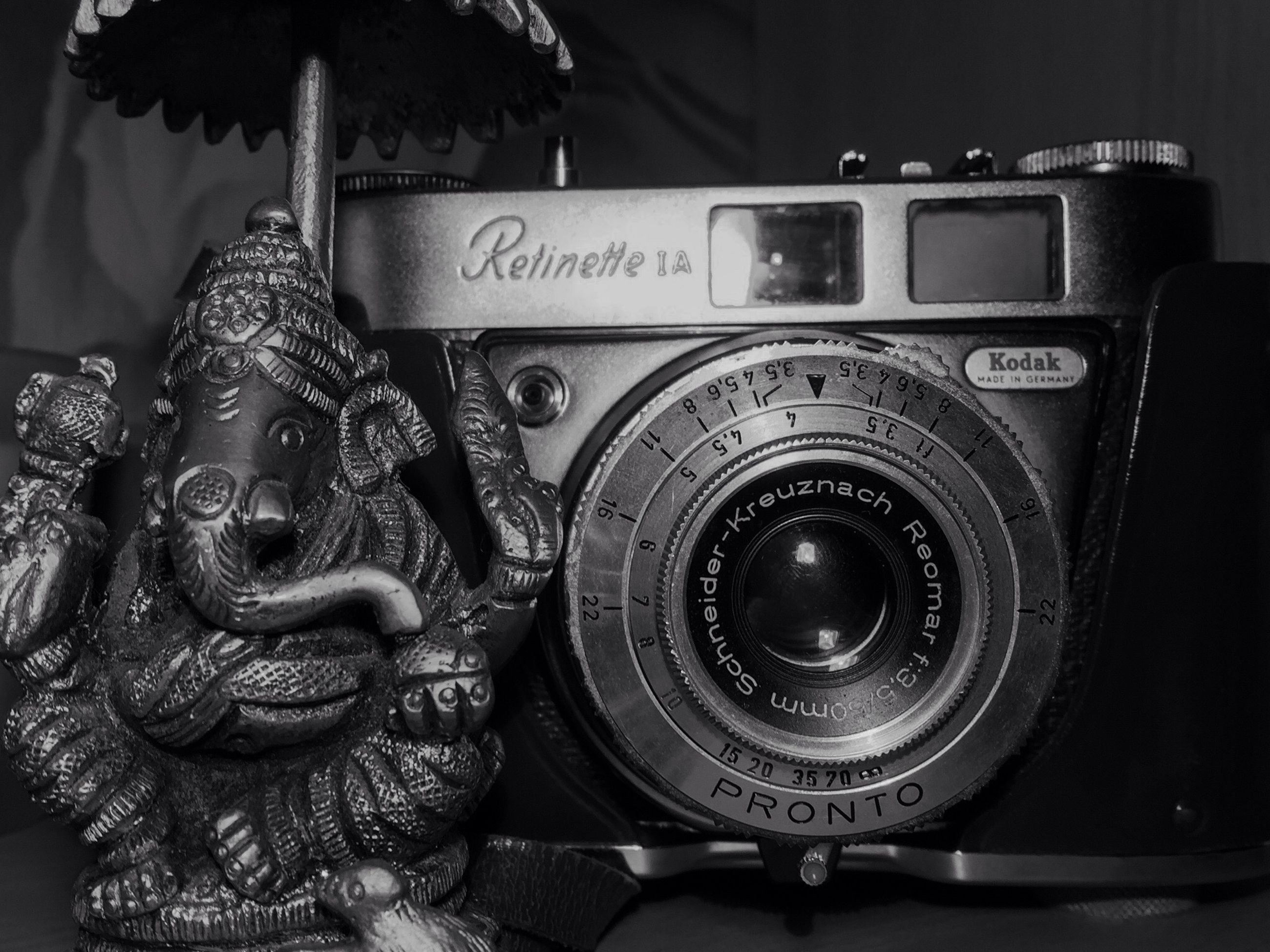 camera - photographic equipment, photography themes, text, close-up, indoors, old-fashioned, no people, technology, day
