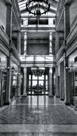 The Arcade Mall Entryway (tall, in Black And White) – Columbia's first shopping center, built in 1912 – is about to get a face-lift... read more here: http://www.thestate.com/news/business/article56317810.html -- Telling Stories Differently HDR Hdr_Collection Blackandwhite Black & White Black&white Noir Et Blanc Noiretblanc Light And Shadow Shadow Shadows Architecture Architectural Column Columns Ceiling Chandelier Building Indoor Architecture Building Interior Geometry Urban Geometry Built Structure Shapes The Architect - 2016 EyeEm Awards