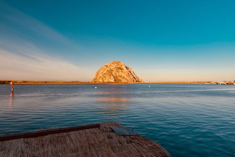 Water Sky Beauty In Nature Scenics - Nature Sea Tranquil Scene Tranquility Rock Nature Rock - Object Solid No People Idyllic Rock Formation Waterfront Sunset Blue Non-urban Scene Outdoors Stack Rock Formation