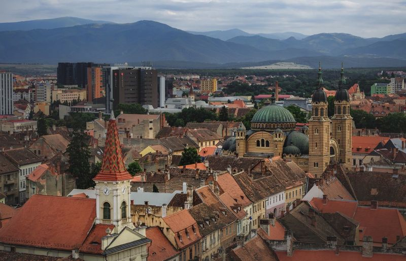 Old town Sibiu Travel Destinations Church Architecture Building Exterior Built Structure City Mountain High Angle View Cityscape Building Residential District Crowd Crowded Mountain Range Sky Outdoors Roof TOWNSCAPE Settlement