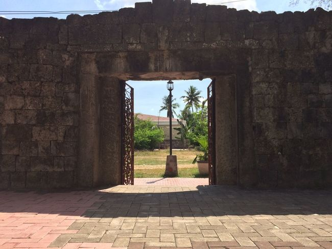 Old Spanish style entrance dating back to the 1800's. Architecture Built Structure History Day Old Ruin Arch Ancient Sunlight No People Shadow Outdoors Travel Destinations Ancient Civilization Sky Tree