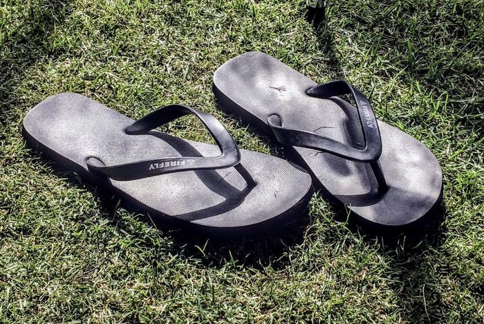 Shoe Pair Grass High Angle View Things That Go Together Two Objects Shoelace No People Directly Above Menswear Dress Shoe Fashion Day Outdoors Soccer Shoe Close-up