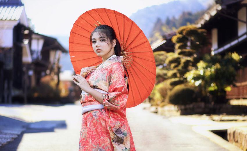 Beautiful girl wearing traditional japanese kimono in tsumago juku at nagano, japan.