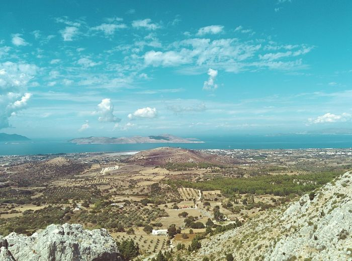 """🇬🇷 in Paleo Pyli. Hiking. Up a mountain. Wearing flipflops only. Btw, if you zoom in a bit, that other """"island"""" righthand is the coast of Turkey 🇹🇷 Mediterranean Landscape View From Above Mediterranean Sea Holiday POV Kos, Greece Kos Island Summer Day Hot Summer Day Horizon Over Water Faintly Colors - 仄か Wilderness Empty Landscape Spaciousness Wide Open Spaces Copy Space Vintage Photo Cinema In Your Life Cinematic Photography My Unique Style Greece Olive Tree Landescape Olive Trees Landscape_Collection The KIOMI Collection Rocks And Trees My Year My View Finding New Frontiers Go Higher"""
