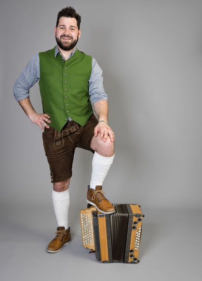 Musician Costume Leather Trousers Tradition Traditional Austria Green Pose Accordion Man Young Shorts Friendly Proud Happy Play Music Fun Joy Single One Background Copy Space Studio Entertainment Mountains Shirt STAND Hobby Leisure Cool Indoors  One Person Studio Shot Front View Full Length Portrait Gray Background Looking At Camera Young Men Smiling Young Adult Casual Clothing Standing Happiness Gray Adult Emotion White Background