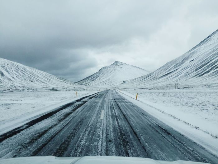 Winter Snow Cold Temperature Winter Weather Sky Nature Beauty In Nature Cloud - Sky Scenics Non-urban Scene Landscape Day Tranquil Scene Outdoors Tire Track Mountain Tranquility No People Mountain Range Travel Beauty In Nature Iceland Asphalt Snow ❄