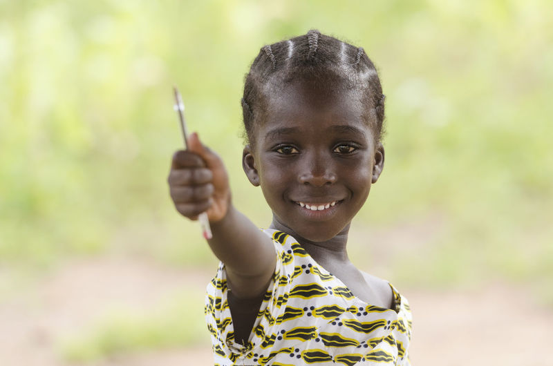 Portrait of smiling girl holding outdoors