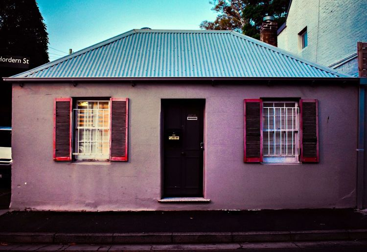 Urban living Suburbia EyeEm Selects Outdoors Picoftheday EyeEm EyeEm Gallery Photography Pink Color Built Structure Architecture Building Exterior Building Window Day No People Residential District House Sky City Communication Outdoors Nature Façade Door Closed Entrance Street Roof