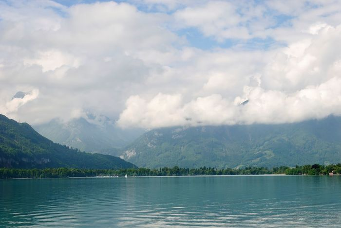 Atmospheric Mood Beauty In Nature Calm Cloud Cloud - Sky Cloudscape Cloudy Cumulus Cloud Day Lake Majestic Mountain Mountain Range Nature Non-urban Scene Outdoors Remote Scenics Sky Solitude Tourism Tranquil Scene Tranquility Water Waterfront