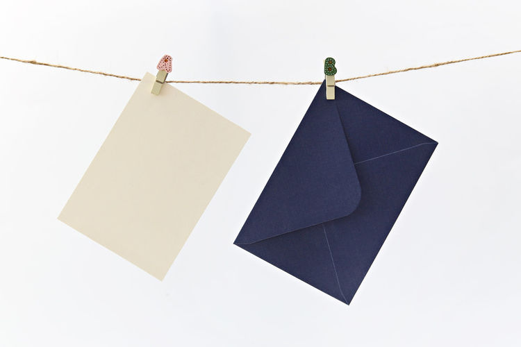 Hanging blue envelope & beige card Copy Space Event Greeting Hanging Memories Promotion Rope Shopping String Announcement Blank Card Envelope Gift Hnager Message Party Photo Sales Tag