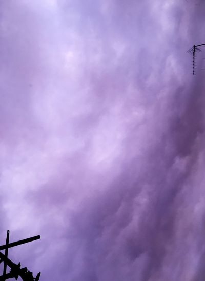 Low angle view of street light against dramatic sky