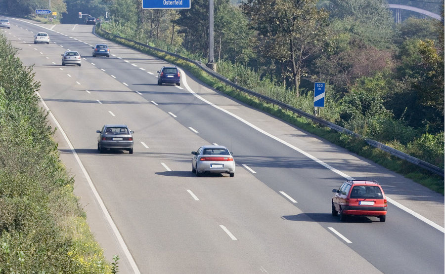 highway with cars overtaking - autobahn in germany A42 Air Pollution Asphalt Autobahn Car Driving Exit Freeway Germany High Angle View Highway Highways&Freeways Mode Of Transport Multiple Lane Highway No People NRW Oberhausen Pollution Road Ruhrgebiet Scenery Speed Traffic Transportation Travel