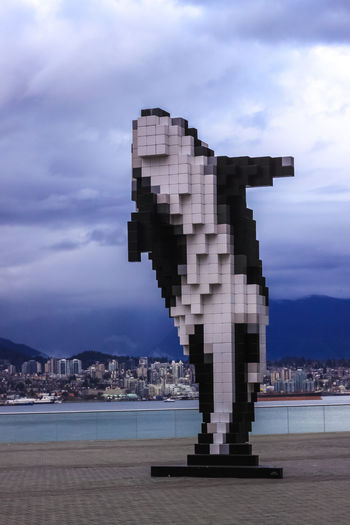 The Digital Orca dominates the foreground in front of the Burrard Inlet in Vancouver. A 2009 sculpture by Douglas Coupland it is often referred to as Lego Orca or Pixel Whale and is made out of steel armature with aluminum cladding of black and white cubes Vancouver, British Colombia, Canada Love Life, Love Photography Architecture Art Bc British Burrard Canada Centre City Cloud - Sky Clouds Convention Coupland Digital Douglas Inlet Killer LEGO No People Orca Pixel Whale Sculpture Sky Vancouver Water Art Is Everywhere