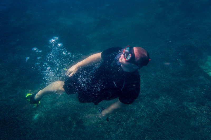 High Angle View Of Mid Adult Man Swimming In Sea