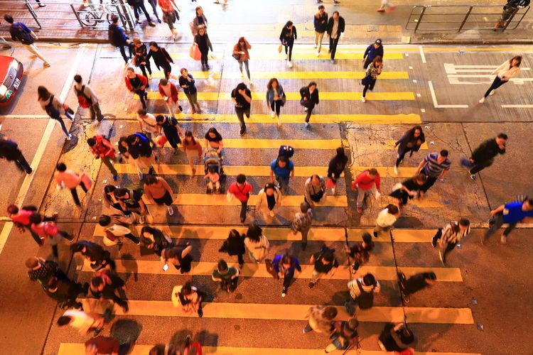 High Angle View Of People Crossing Road In City At Night