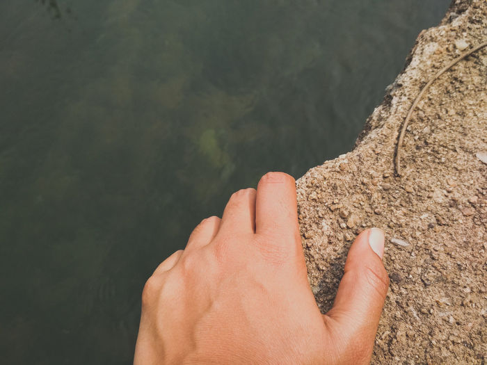 Water Lake Holding Human Hand Water Low Section Close-up Personal Perspective Palm Human Finger Cropped Finger Shore