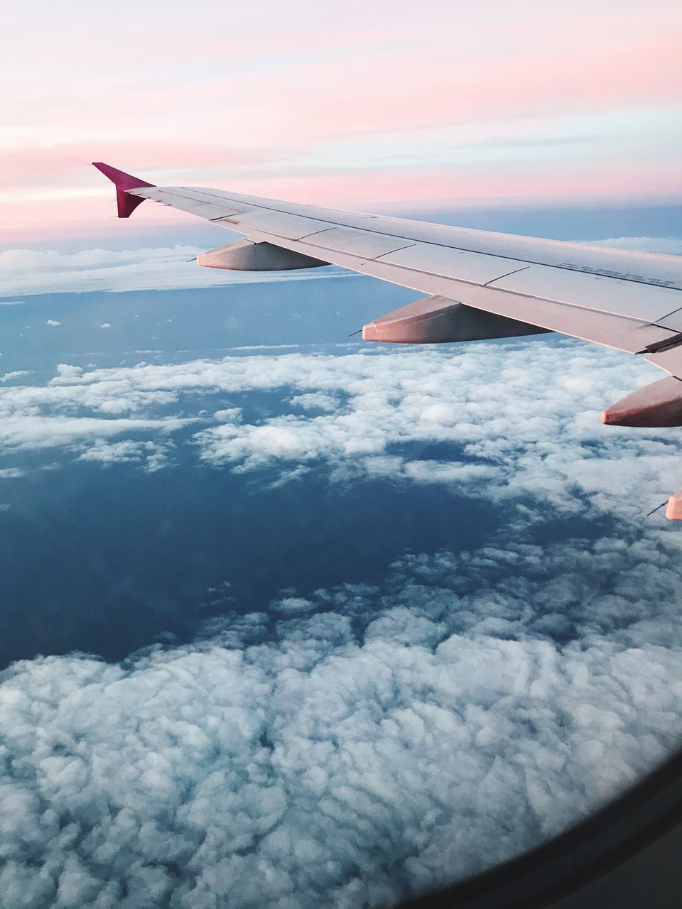 airplane, sky, cloud - sky, air vehicle, human hand, airplane wing, transportation, nature, beauty in nature, flying, mid-air, mode of transport, aerial view, outdoors, aircraft wing, day, real people, scenics, one person, human body part, people