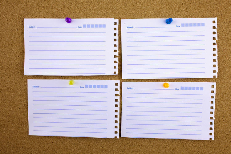 Close-up of papers on bulletin board