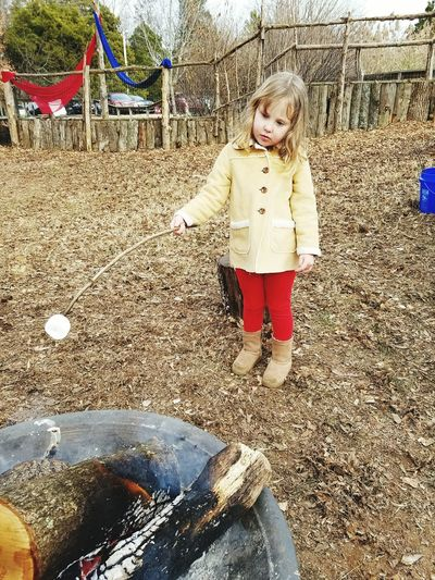 Marshmallows on an open fire. Nature_collection Childhood One Person Front View Outdoors Day People Leisure Activity Daddy's Girl Dadstuff Dadthings Fatherhood Moments Real People Fire Full Length Marshmallows
