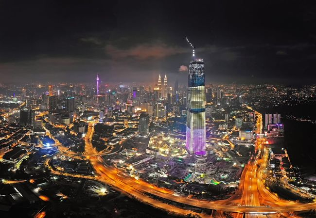 Kuala Lumpur cityscape at night Travel Destinations Travel View Outdoor Landscape Aerial View Aerial Shot Aerial Photography Malaysia Getty Images EyeEm Best Shots EyeEm Selects City Cityscape Urban Skyline Illuminated Modern Skyscraper Multi Colored Sky Architecture Building Exterior Financial District  Office Building Tall - High Tower Tourist Attraction  Downtown District Office Building Exterior Skyline