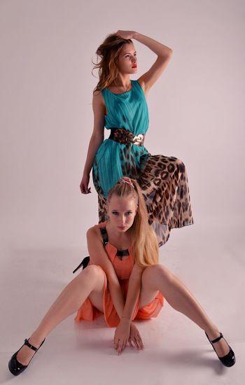 Female models posing against white background