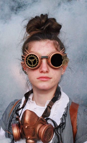 Portrait of teenager girl wearing sunglasses with gas mask