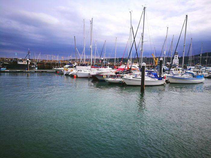 boats on green Sailboat Boats⛵️ Harbor Green Sea Seaside Water Blue Sky