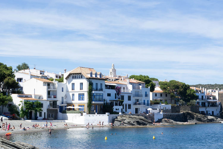 Houses by sea against sky at cadaques