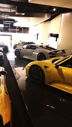 Car Transportation Land Vehicle Mode Of Transport Street Road City City Life Rush Hour Yellow Below Outdoors Parked No People