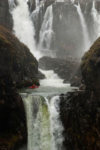 Kayaker waiting to drop over White River Falls in Oregon. Waterfall Water Motion Rock Kayak Kayaking Outdoors Adventure Oregon Central Oregon Pacific Northwest  Day White River Falls