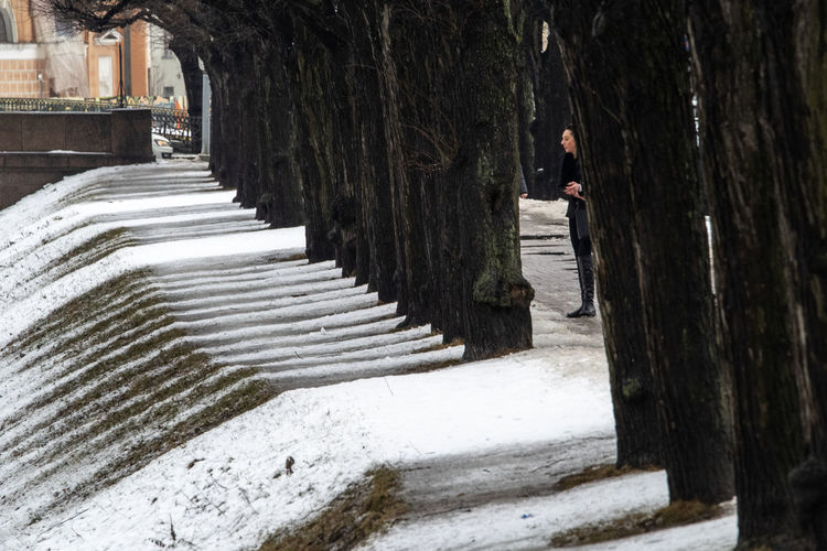 Man walking on staircase by tree