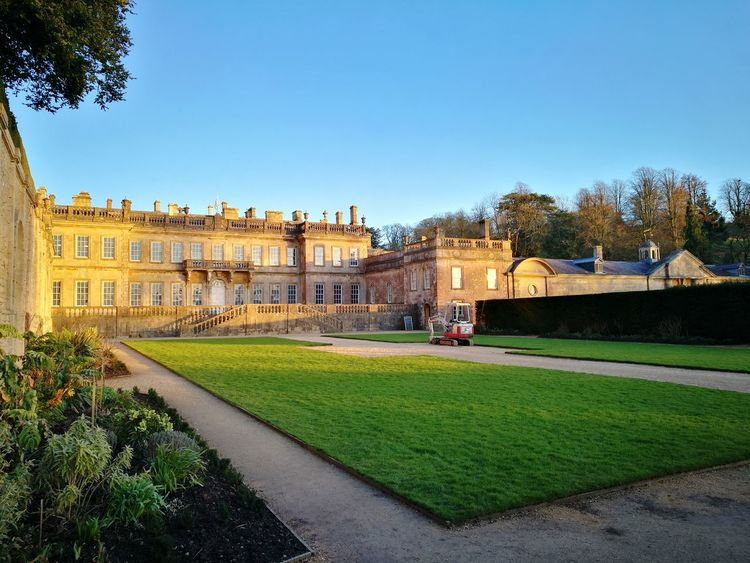 Country Manor Stately Home Gravel Public Garden Country House Early Spring Formal Garden Yew Hedges Architecture Palace Travel Destinations History Built Structure Statue Grass Building Exterior Blue Outdoors Sky Day