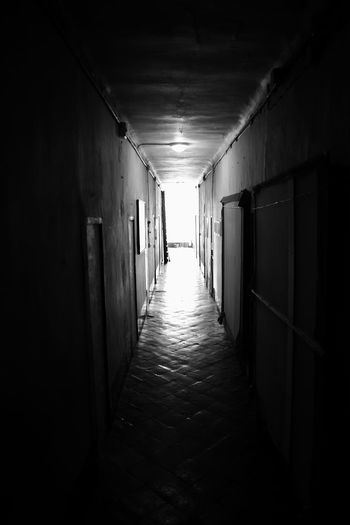 Corridor Fujifilm X-E2 Absence Alley Architecture Blackandwhite Building Built Structure Corridor Diminishing Perspective Direction Door Empty Entrance Fujifilm Fujifilm_xseries Indoors  Light At The End Of The Tunnel Long Narrow No People The Way Forward Tunnel vanishing point Wall - Building Feature