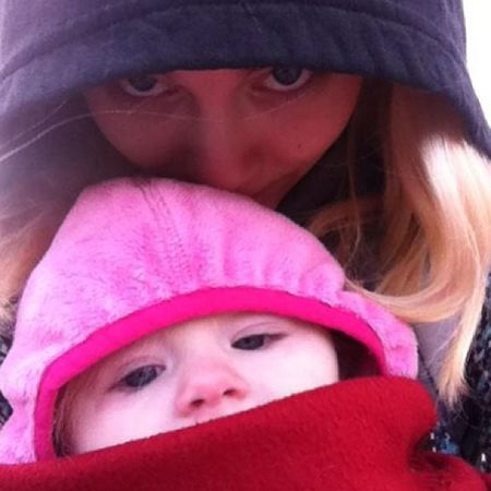 Watching uncle Michael play football last winter. Pink nose, pink hood. Ckc2013oct Cutekidsclub Day14 Pink