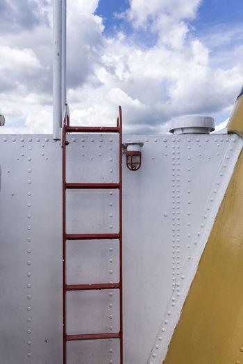 Ladder on ship against sky