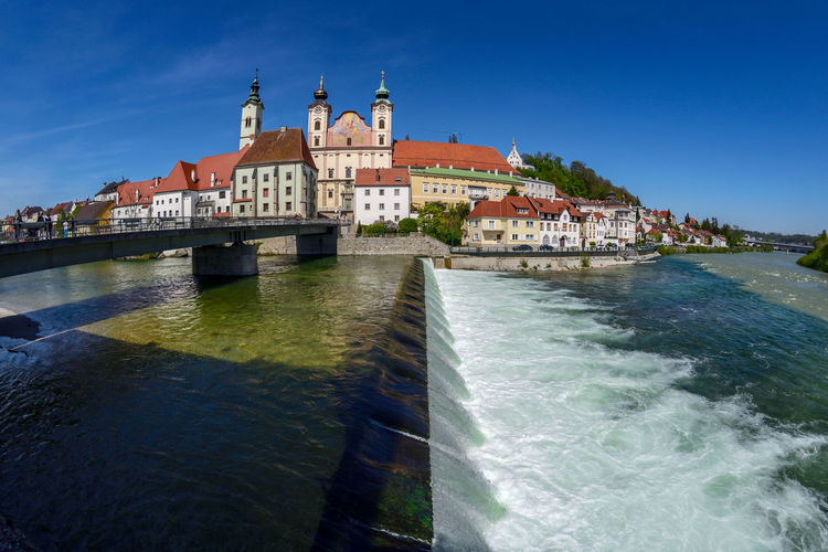 View on Steyr in Upper Austria / Austria Water Building Exterior Architecture Built Structure Sky Travel Destinations Building Nature Blue Travel Tourism Day Motion Waterfront City Sea No People The Past History Outdoors Canal Steyr Upper Austria  Austria
