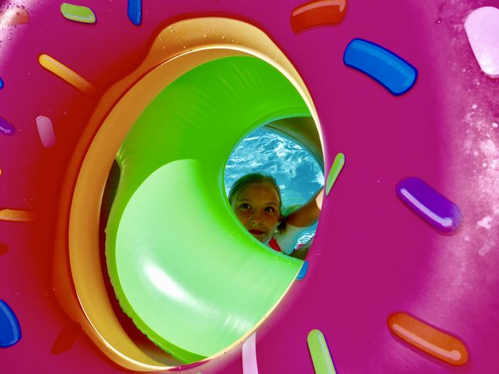 Getty Premium Collection Premium Child Childhood Children Only Day Multi Colored One Girl Only Blond Hair Blonde Girl Inflatable  Pool One Person People Playing Selected For Premium Pool Toys Peaking Through Elementary Age Blonde Hair Blond Girl