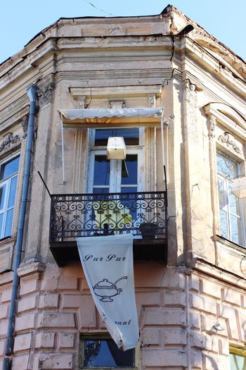 Banner hanging from the balcony of a Tbilisi restaurant called Pur Pur. Pur Pur Tbilisi Restaurant Tbilisi Georgia Tbilisi Architecture Building Exterior Built Structure Low Angle View No People Text Day