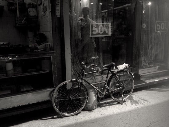 India Architecture Bicycle Black And White Building Exterior Built Structure City Communication Day Footpath Glass - Material Incidental People Land Vehicle Mode Of Transportation Monochrome Outdoors Sidewalk Stationary Store Street Text Transportation Wheel