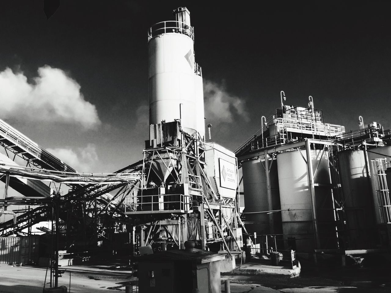industry, sky, factory, built structure, outdoors, no people, low angle view, day