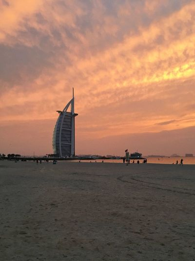 Jumeirah Beach. Dubai, UAE Architecture Beach Beach Life Built Structure Burj Al Arab Cloud - Sky Coastline Dubai Ferris Wheel Jumairah Jumeirah Beach Nature Nautical Vessel No People Outdoors Sand Sea Sky Sunset Travel Travel Destinations Travel Photography UAE Vacation Water
