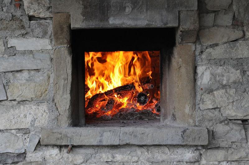 Bonfire against wall